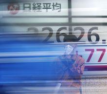 Asian markets inch higher after Wall Street rally, despite rising coronavirus fears