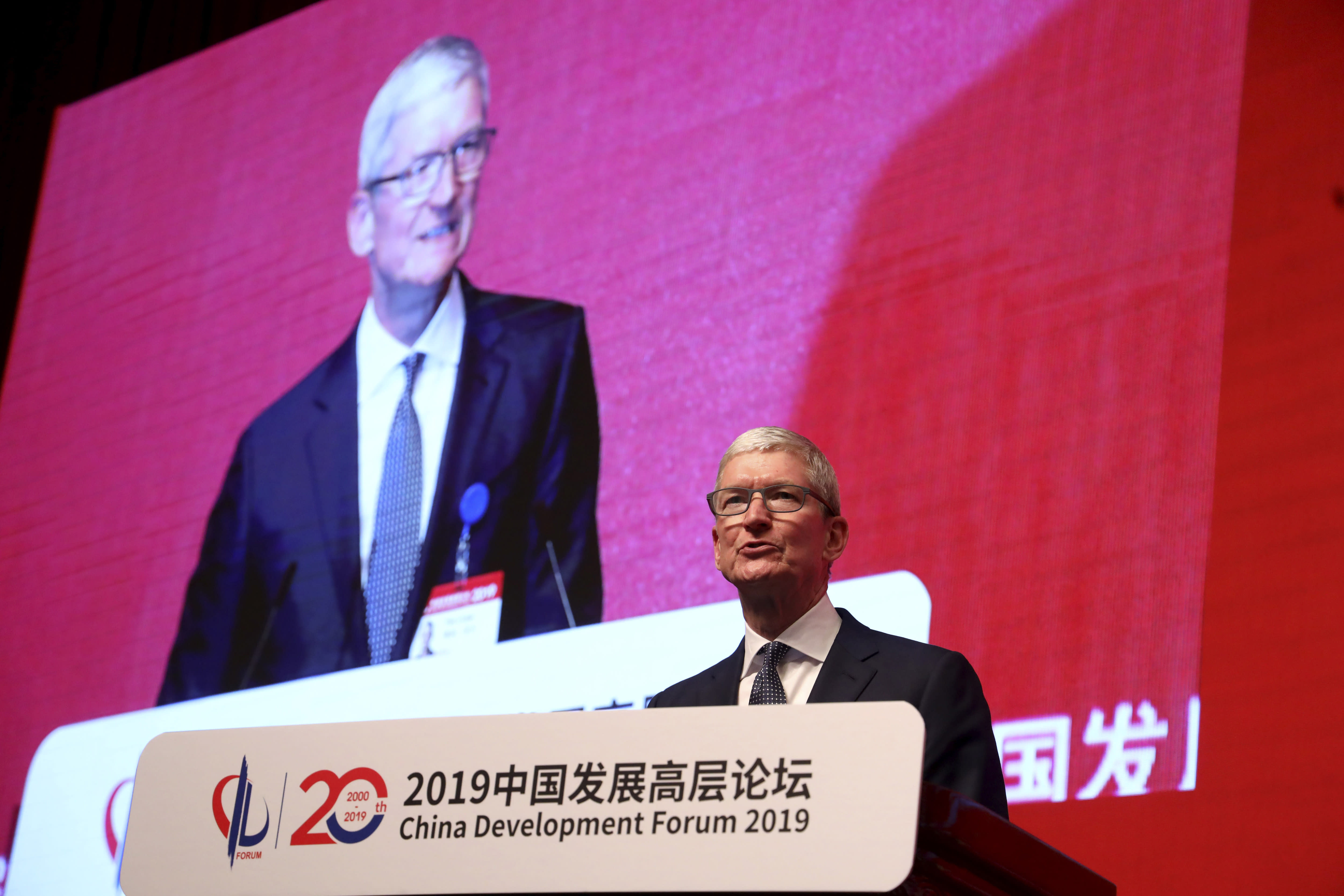 """Apple CEO Tim Cook speaks at the Economic Summit held for the China Development Forum in Beijing, China, Saturday, March 23, 2019. Cook says he's """"extremely bullish"""" about the global economy based on the amount of innovation being carried out, and he's urging China to continue to """"open up."""" (AP Photo/Ng Han Guan)"""