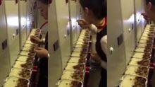 Flight attendant suspended after filming herself eating leftover in-flight meal