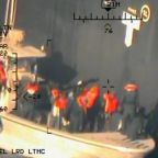 U.S. releases photos reportedly show Iranians removing unexploded mine from oil tanker