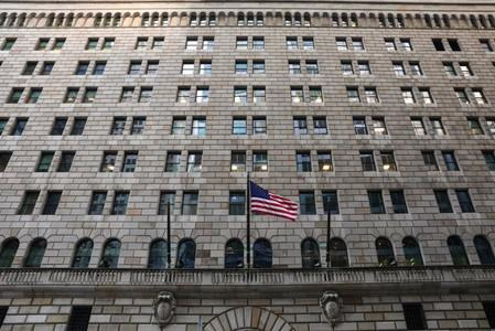 The U.S. flag flies on the Federal Reserve Bank of New York in the financial district in New York