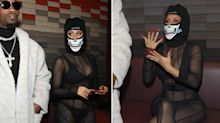 Cardi B wears sheer bodysuit and helmet-style mask at Paris Fashion Week