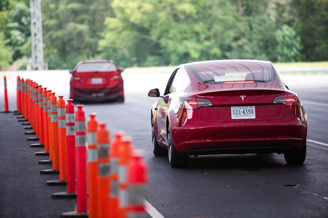 Joe Young, a media relations associate for the Insurance Institute for Highway Safety (IIHS), demonstrates a front crash prevention test on a 2018 Tesla Model 3 at the IIHS-HLDI Vehicle Research Center in Ruckersville, Virginia, U.S., July 22, 2019. Picture taken July 22, 2019. REUTERS/Amanda Voisard
