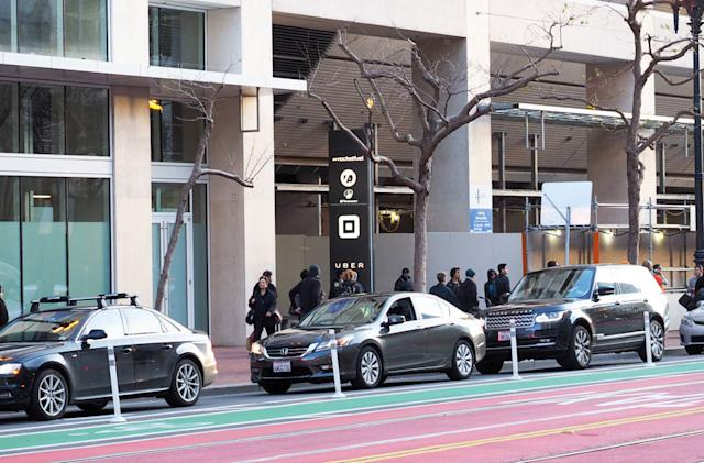 Uber joins public transport group to win back city trust