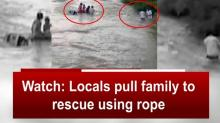 Watch: Locals pull family to rescue using rope