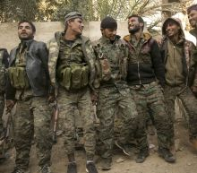 Troops celebrate as US-backed force seizes IS camp in Syria