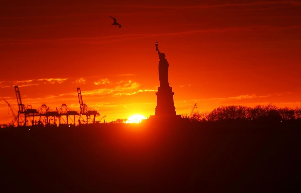 The Statue of Liberty, a US symbol of immigration stands in New York Harbor at sunset in New York City (AFP Photo/SPENCER PLATT)