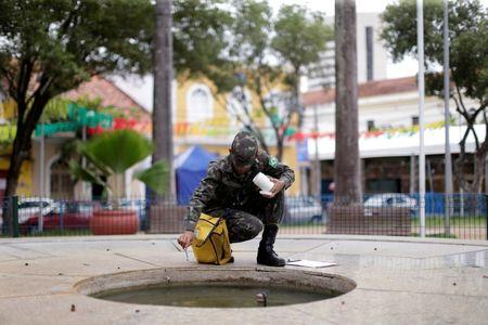 Brazilian soldiers conduct an inspection for the Aedes aegypti mosquito on a street in Recife Brazil, February 1, 2016. REUTERS/Ueslei Marcelino