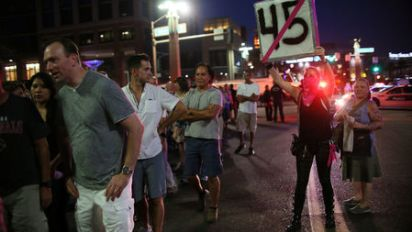 Police use gas to disperse protesters outside Trump rally in Phoenix