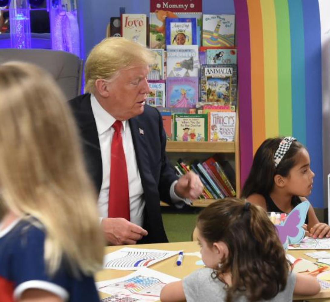 Trump coloring an American flag wrong