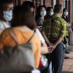 Taiwan raises COVID-19 alert level amid surge in cases