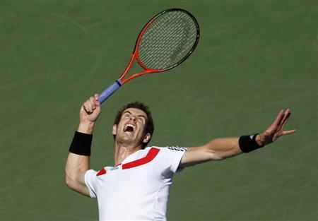 Murray of Britain serves to Wawrinka of Switzerland at the U.S. Open tennis championships in New York