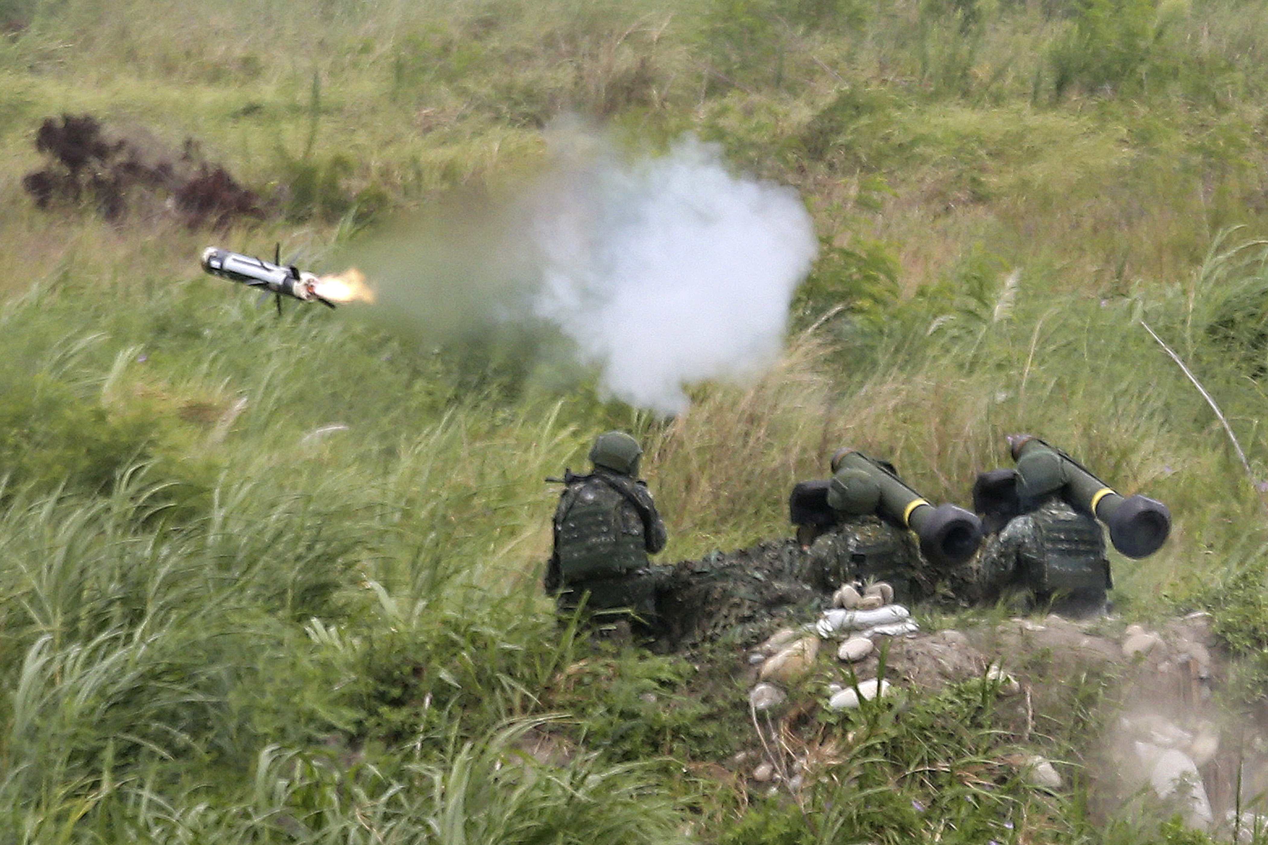 An FGM-148 Javelin anti-tank missile is fired during the 36th Han Kung military exercises in Taichung City, central Taiwan, Thursday, July 16, 2020. (AP Photo/Chiang Ying-ying)