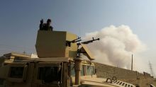 Iraqi Kurds claim capture of town in advance on Mosul