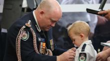 Bravery award for dead firefighter presented to infant son