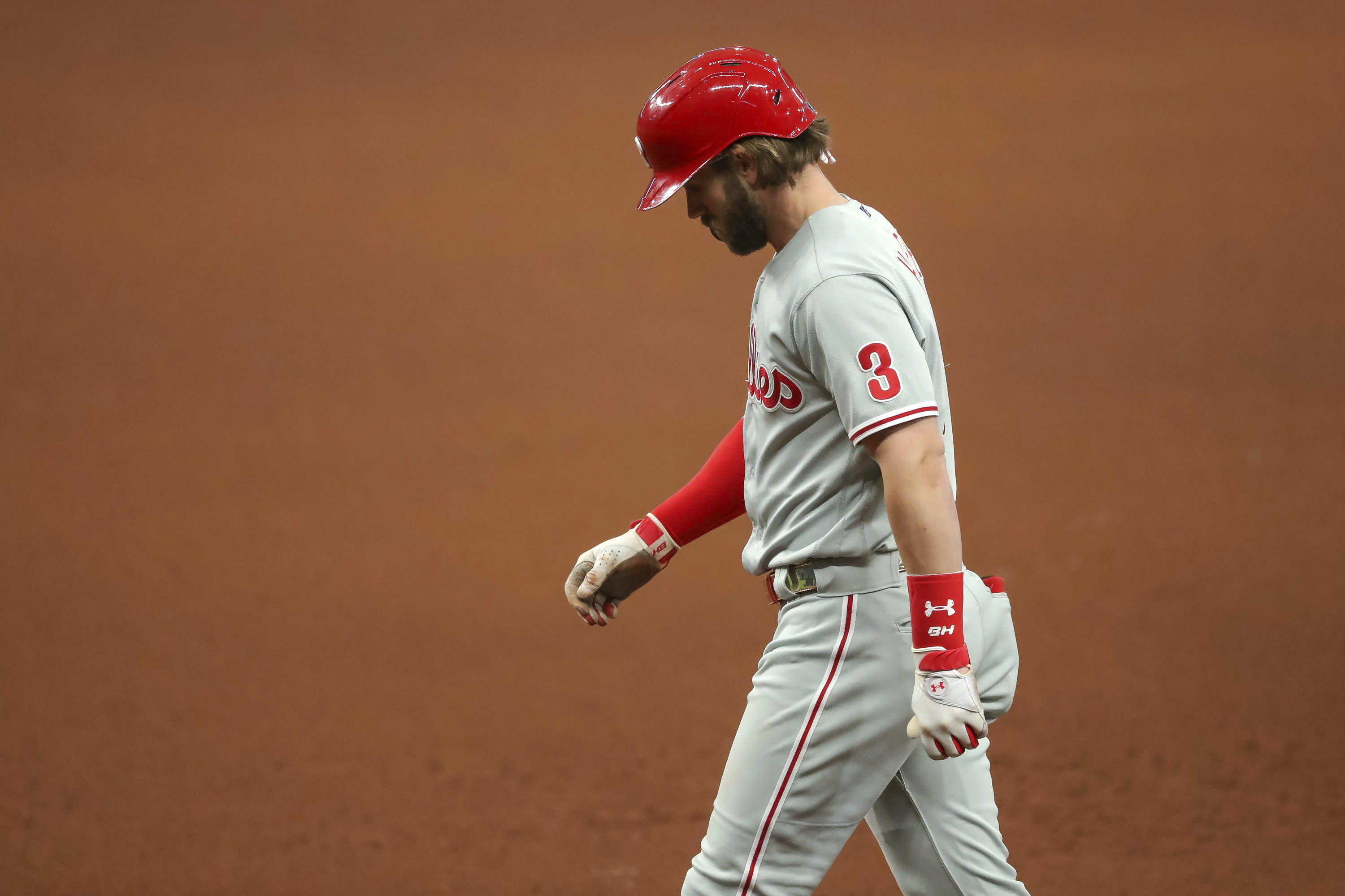 Philadelphia Phillies' Bryce Harper reacts after grounding out against the Tampa Bay Rays during the eighth inning of a baseball game Sunday, Sept. 27, 2020, in St. Petersburg, Fla. (AP Photo/Mike Carlson)