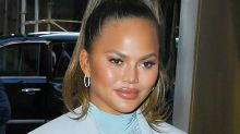 Chrissy Teigen Debuts New Hair Style With Nude Sandals & Pink Blazer Dress