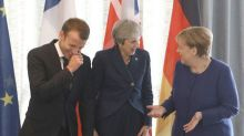 Please, no Brexit talk: Merkel, Macron hit the bar for beer and fries