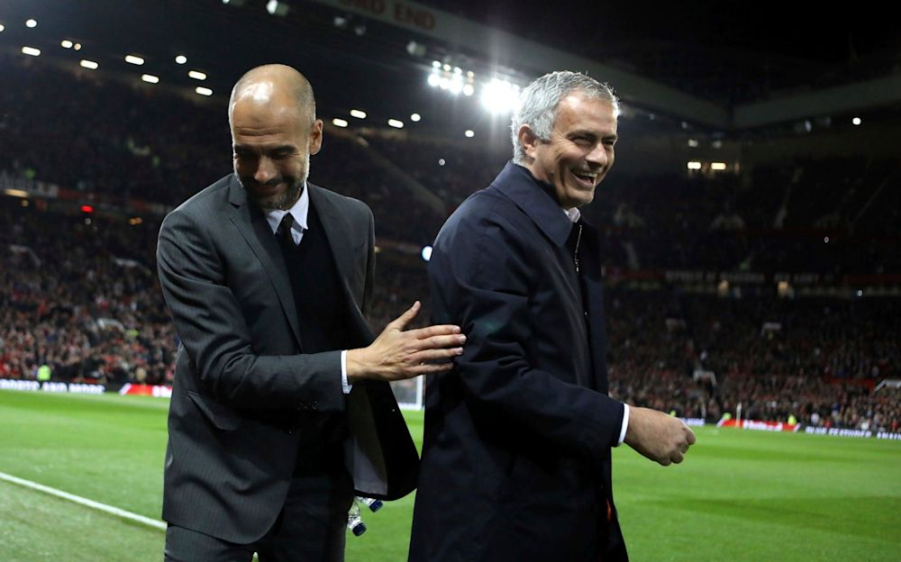 Pep Guardiola (L) and Jose Mourinho go head to head on Thursday night - AP