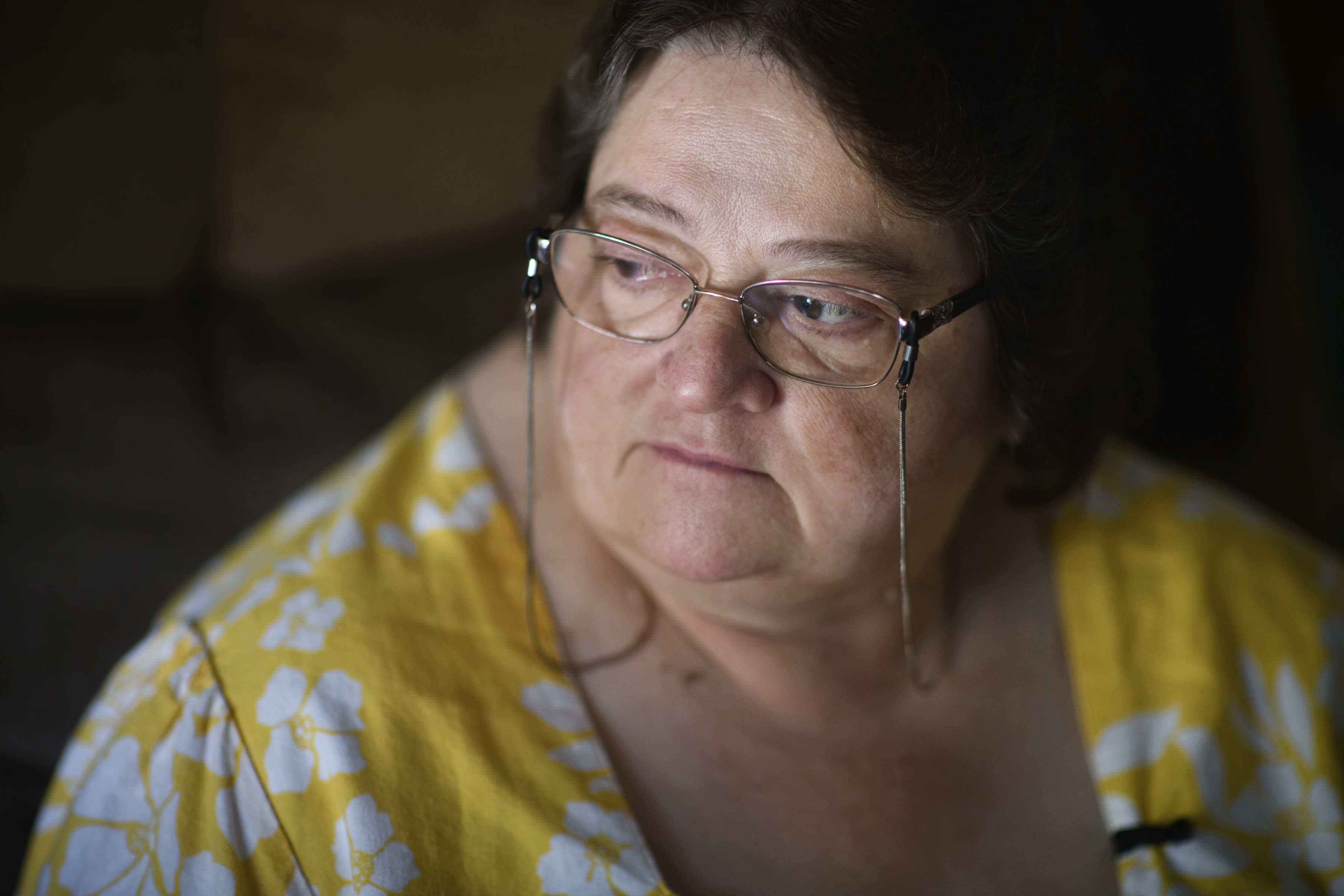 """Doris Kelly, 57, sits in her home on Monday, June 29, 2020 in Ruffs Dale, Pa. Kelly was one of the first patients in a University of Pittsburgh Medical Center trial for COVID-19. """"It felt like someone was sitting on my chest and I couldn't get any air,"""" Kelley said of the disease. (AP Photo/Justin Merriman)"""
