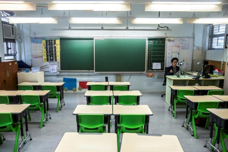 So far, 29 countries -- including Ireland, China, Italy, Poland and Japan -- have suspended classes nationwide, affecting nearly 400 million kids (AFP Photo/ISAAC LAWRENCE)