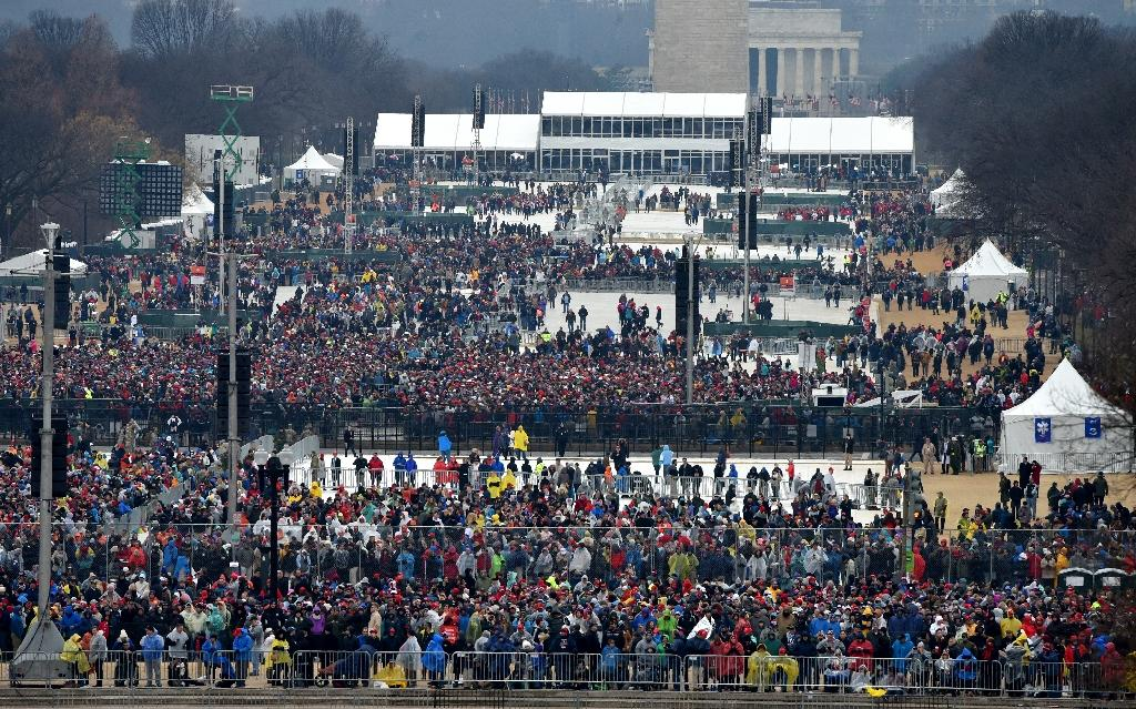 Crowd on the National Mall during inauguration ceremonies for Donald Trump in Washington, DC on January 20, 2017 (AFP Photo/Paul J. Richards)