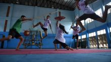 With swords and stunts, Thai youth embrace ancient martial art