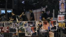 The Latest: Hong Kong protest activists reject apology
