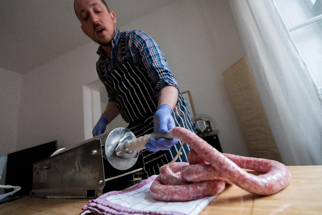 Based in Vienna, Richard Holmes sells his handmade 'Britwurst' creations to a growing number of restaurants and shops and at markets (AFP Photo/Joe Klamar)
