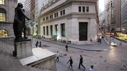 Wall St. opens higher on tax bill optimism