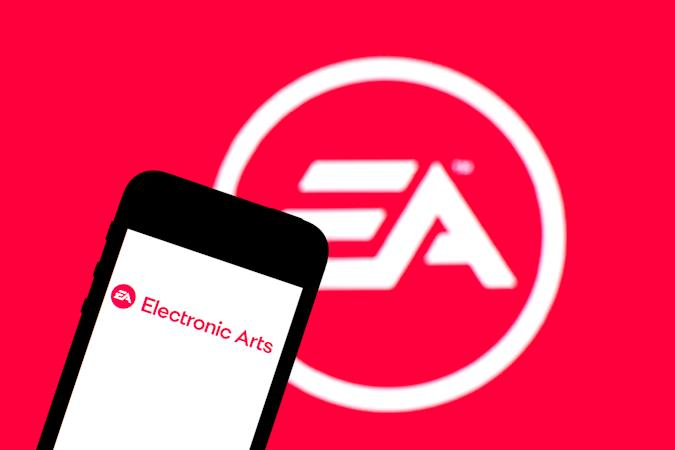 SPAIN - 2021/06/29: In this photo illustration an Electronic Arts Inc. logo seen displayed on a smartphone with a Electronic Arts Inc. logo in the background. (Photo Illustration by Thiago Prudêncio/SOPA Images/LightRocket via Getty Images)