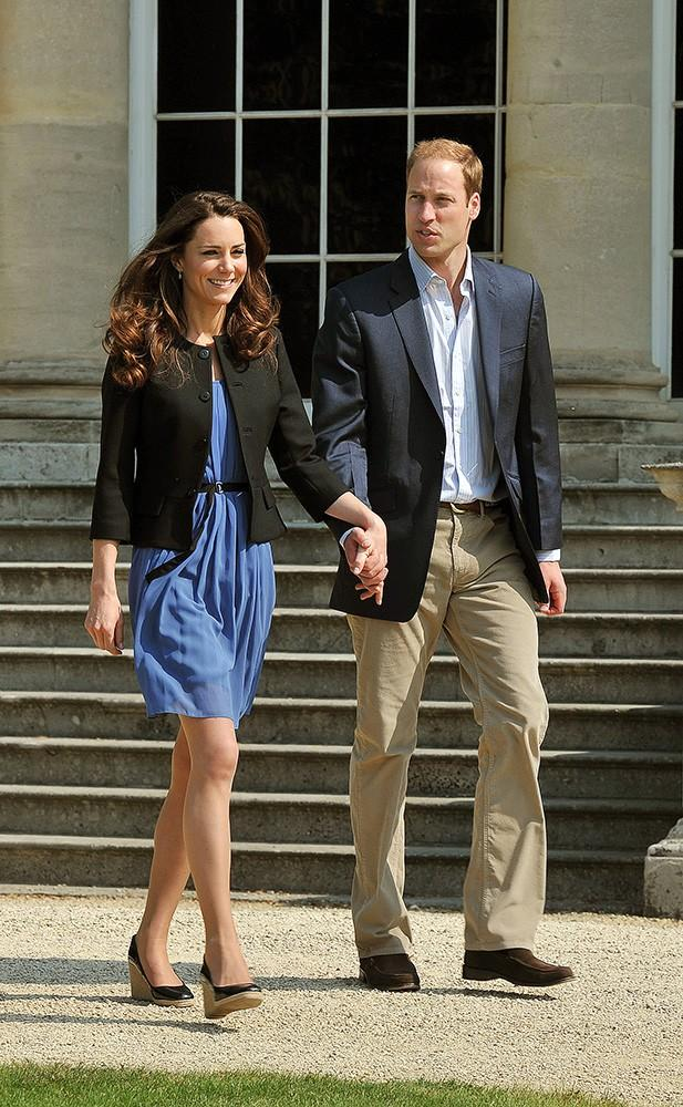 Kate and William headed out for their honeymoon the day after their wedding, Kate dressed in a simple belted blue dress and her L.K. Bennett wedges.
