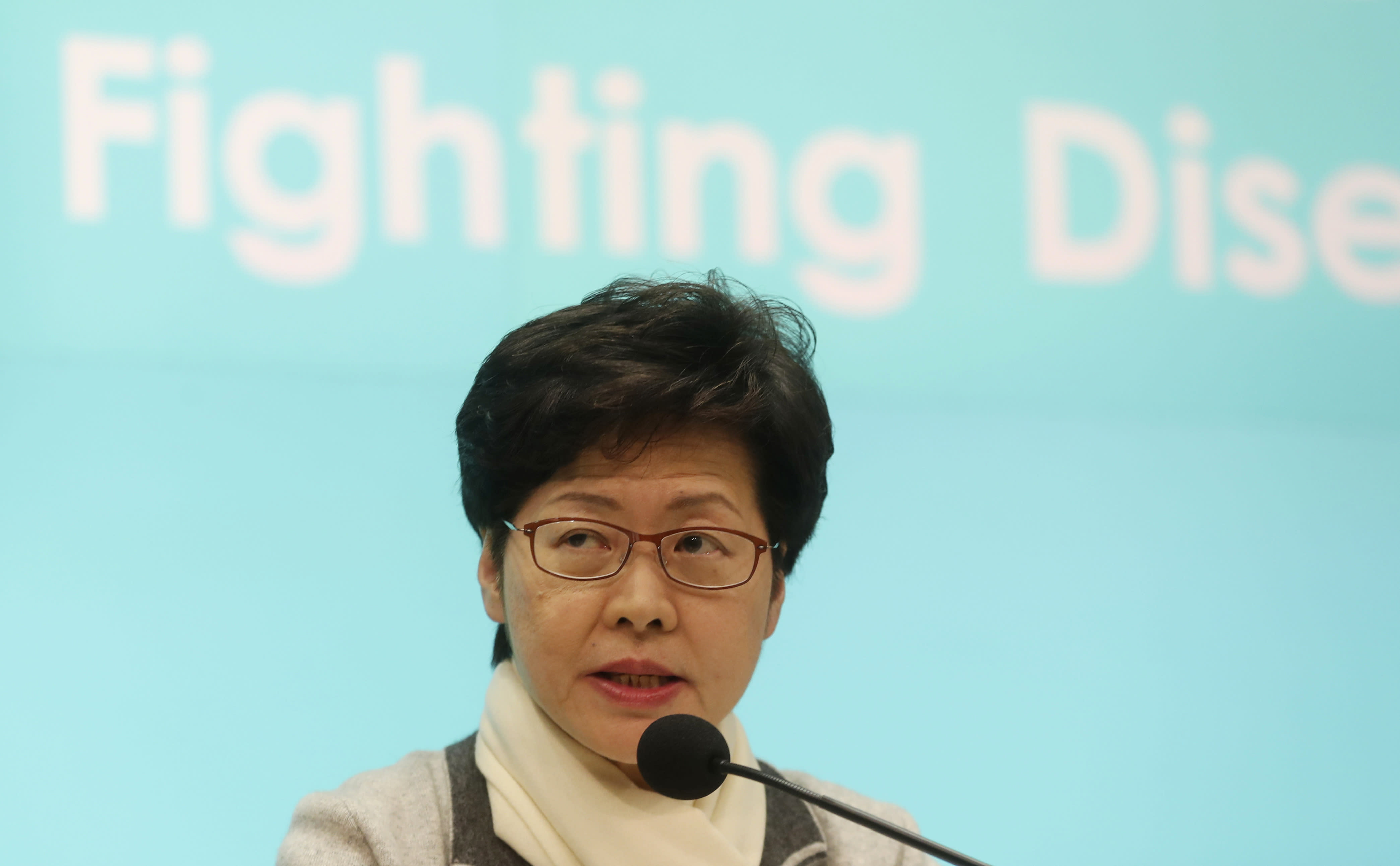 Hong Kong Chief Executive Carrie Lam speaks during a press conference held in Hong Kong Saturday, Jan. 25, 2020. The virus-hit Chinese city of Wuhan, already on lockdown, banned most vehicle use downtown and Hong Kong said it would close schools for two weeks as authorities scrambled Saturday to stop the spread of an illness that has infected more than 1,200 people and killed 41. (AP Photo/Achmad Ibrahim)