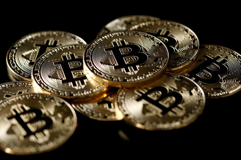 Bitcoin slumps 14% as pullback from record gathers pace - Yahoo Finance
