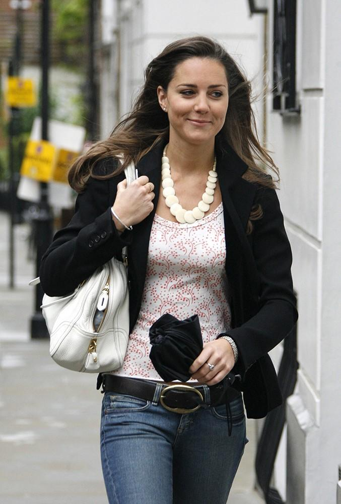 Kate smiles in a casual top and jeans in London.