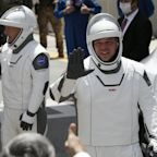 Astronauts board SpaceX rocket for historic flight