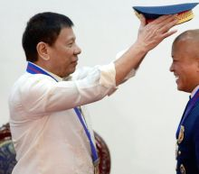 Taking Selfies With Duterte's Chief Executioner