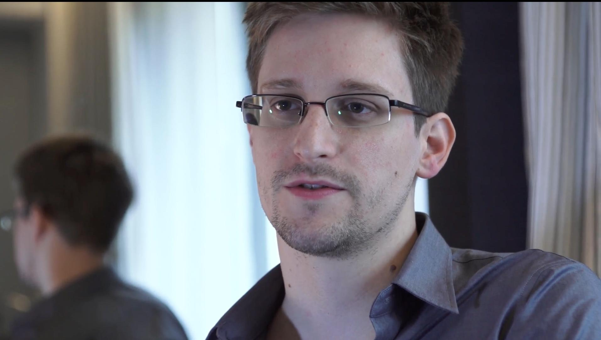 This photo provided by The Guardian Newspaper in London shows Edward Snowden, who worked as a contract employee at the National Security Agency, on Sunday, June 9, 2013, in Hong Kong. NSA leaker Edward Snowden claims the spy agency gathers all communications into and out of the U.S. for analysis, despite government claims that it only targets foreign traffic. (AP Photo/The Guardian, Glenn Greenwald and Laura Poitras)