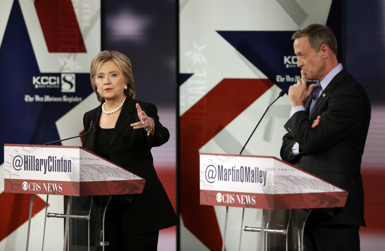 <p><i>Hillary Rodham Clinton makes a point as Martin O'Malley listens during the Democratic debate in Des Moines, Iowa, on Saturday. (Photo: Charlie Neibergall/AP)</i></p>