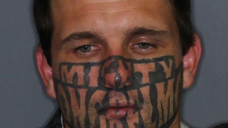 Wanted criminal on the run with very distinctive face tattoo