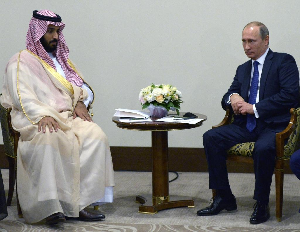 Russian President Vladimir Putin (R) meets with Mohammad bin Salman Al Saud, who is Deputy Crown Prince, Second Deputy Prime Minister and Defense Minister of Saudi Arabia, on October 11, 2015 in Sochi