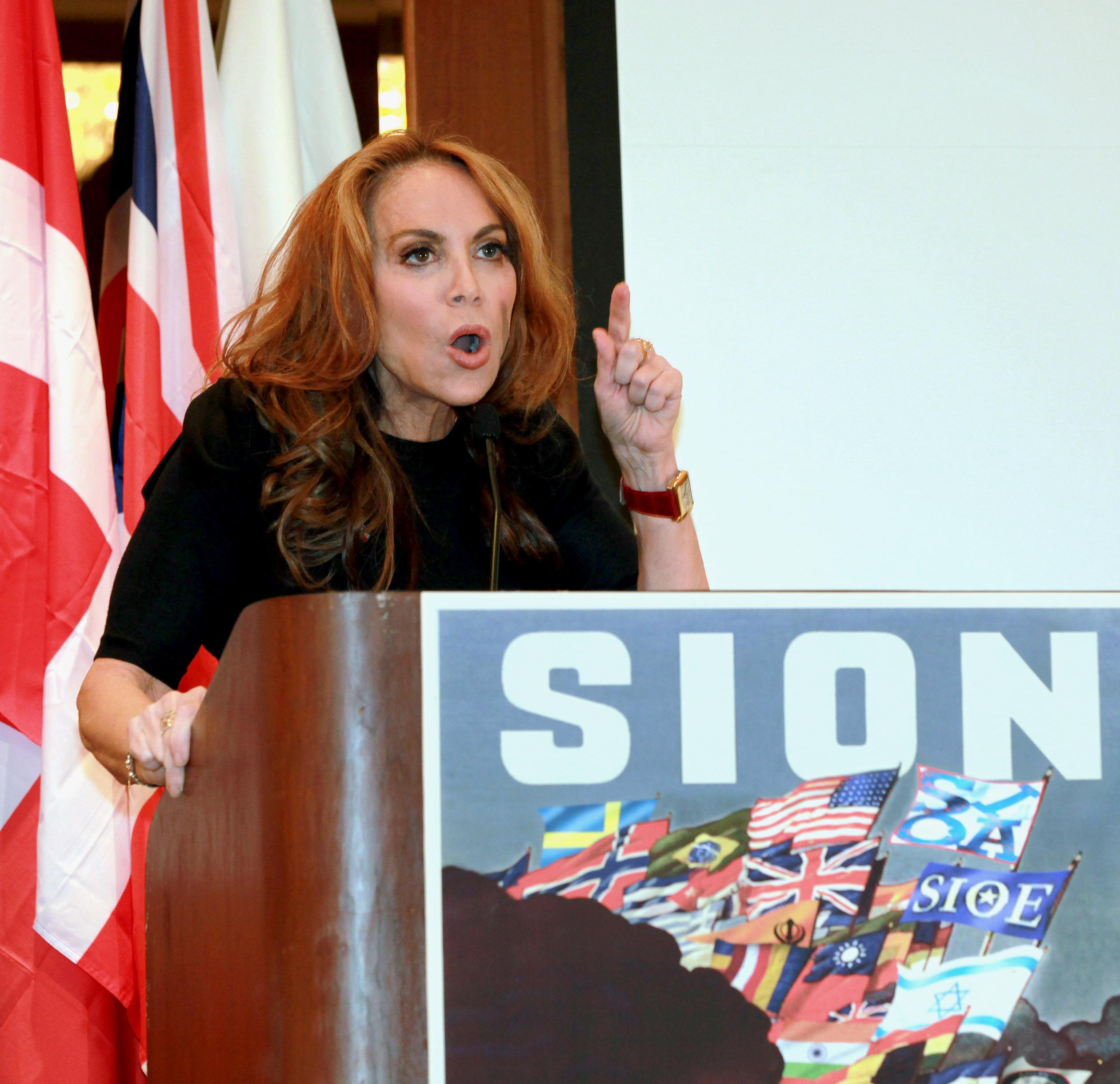 """In this Sept. 11, 2012 photo, anti-Islamic blogger Pamela Geller, speaks at a conference she organized entitled; """"Stop Islamization of America,"""" in New York. An advertising campaign initiated by Geller's group, """"The American Freedom Defense Initiative,"""" will have its ads that equate foes of Israel with """"savages"""" appearing in 10 New York City subway stations after a federal judge ordered the Metropolitan Transportation Authority to put them up. (AP Photo/David Karp)"""