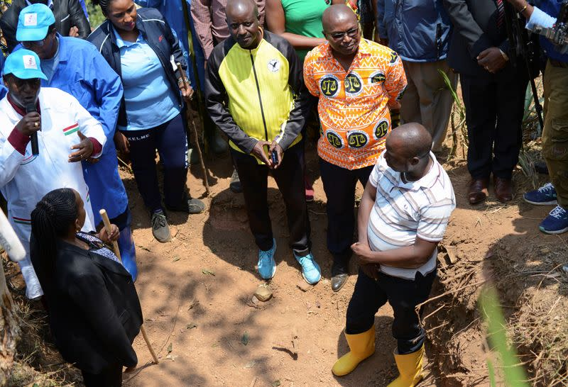 Chairman of Truth and Reconciliation Commission Pierre Claver Ndayicariye addresses delegates near a 1972 mass grave as they prepare to extract bodies in Gikuzi village, Vugizo commune in Makamba Province