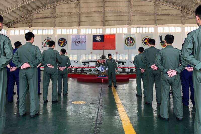 Soldiers gather in front of an Indigenous Defense Fighter (IDF) fighter jet and missiles at Makung Air Force Base in Taiwan's offshore island of Penghu