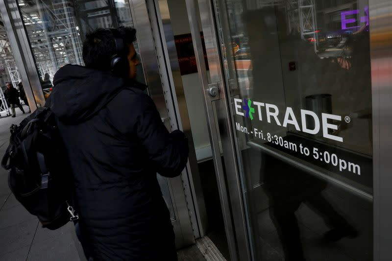 FILE PHOTO: A man enters E*Trade Financial offices, after it was announced that Morgan Stanley is buying the discount brokerage, in New York