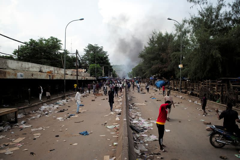 Smoke rises supporters of the Imam Mahmoud Dicko and other opposition political parties protest against President Ibrahim Boubacar Keita in Bamako