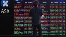 ASX200 gains, closes just under 7,000