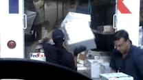 Fed-Ex worker caught hurling packages into back of truck