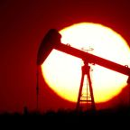 Oil slides as OPEC+ delays decision on output cuts