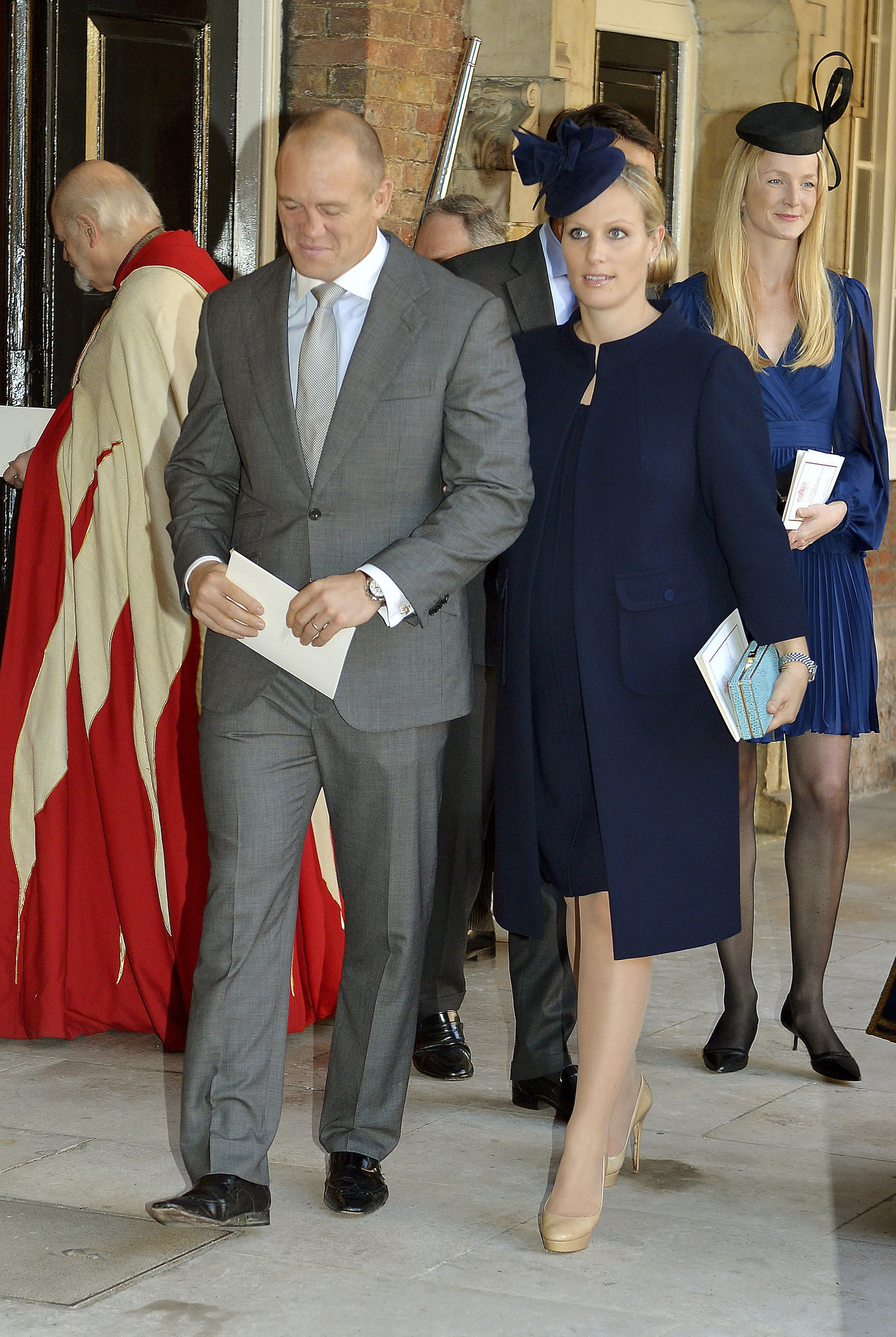 Britain's Zara Philips and her husband Mike Tindall leave after the christening of Prince George at St James's Palace in London October 23, 2013. REUTERS/John Stillwell/pool  (BRITAIN - Tags: ROYALS ENTERTAINMENT SOCIETY)